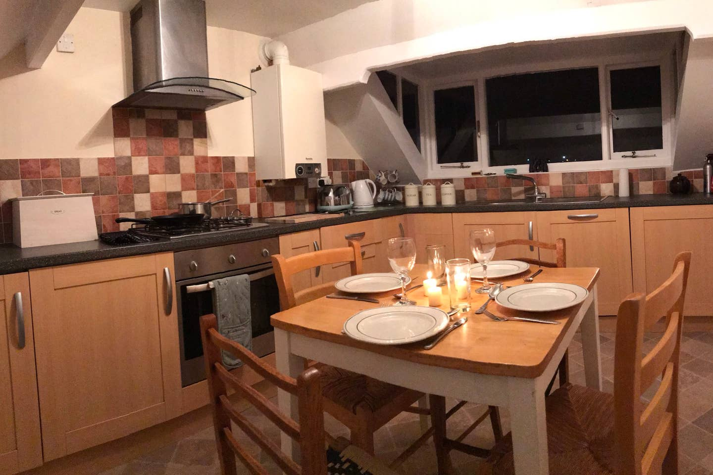 Large dinning kitchen with views over the harbour and out to sea