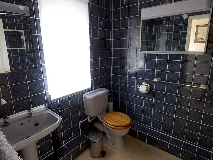 Fully tiled bathroom with power shower