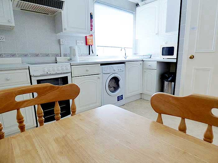 Spacious fully fitted kitchen with dining table
