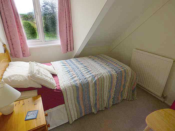 The single bedroom as beautiful views to the rear of the moorland