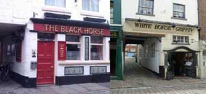 The White Horse and the Black Horse public houses in Whitby, in reality they are not quite next door to each other as they look in this picture